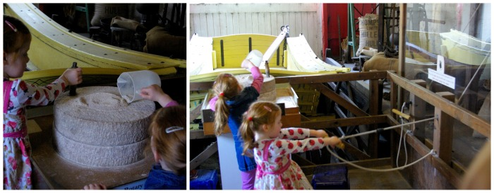 Trying out the milling machinery at Skidby Mill