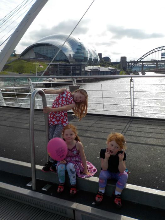 Posing on the bridge over the river Tyne