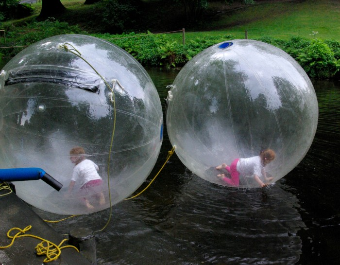 Water zorbs at River Dart Country Park in Devon