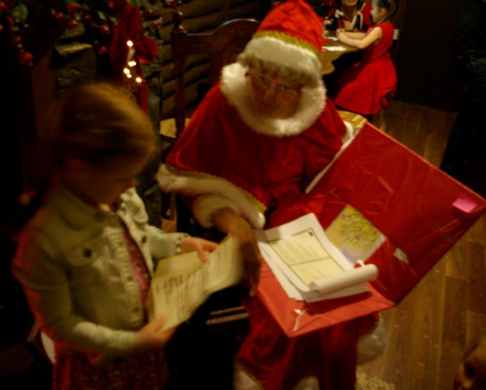 Helping Mrs Claus with letters at Princes Quay