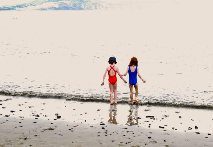 Paddling in the sea at Lyme Regis