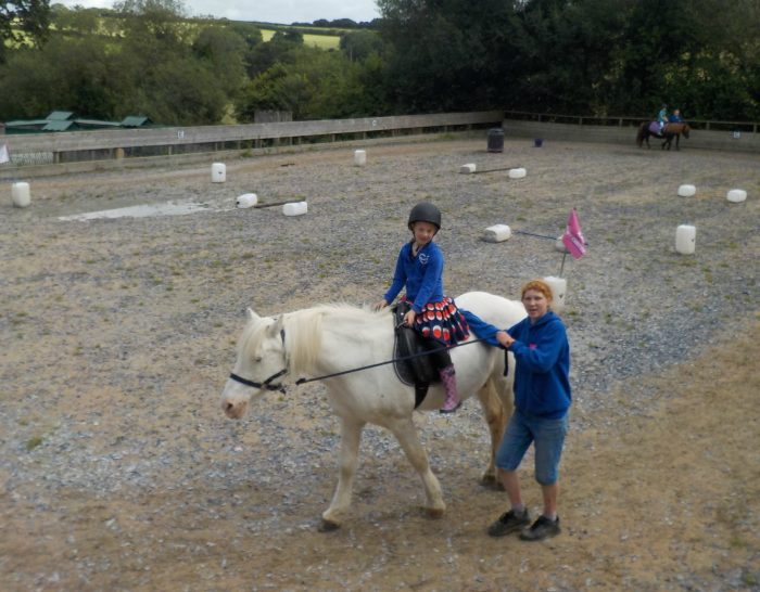 A pony ride at The Miniature Pony Centre