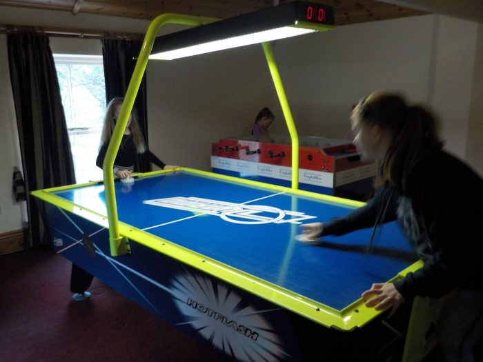 Playing air hockey at Sandybrook Country Park