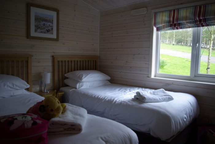 One of the twin bedrooms in lodge 65 Sandybrook Country Park