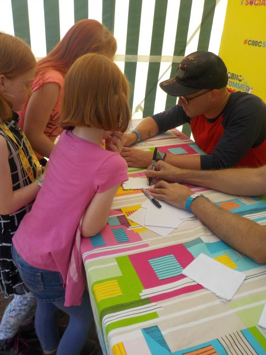 Getting their lanyards signed by Art Ninja at CBBC Summer Social 2018